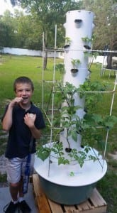 Matthew with Our New Tower Garden