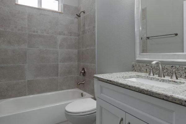 Guest Bathroom Vanity | Grey Countertops | White Cabinets
